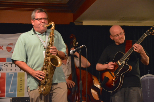 "l-r John Nugent on sax, Co-Producer/Artistic Director of the XRIJF jams with his long time friend Bob Sneider on guitar at the ""After Party"" jam session."